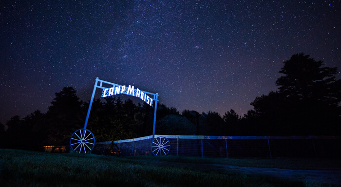 Camp Marist sign at night