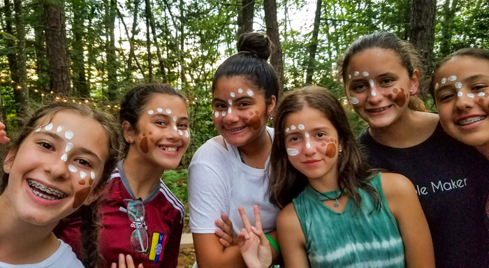 Group of campers with painted faces