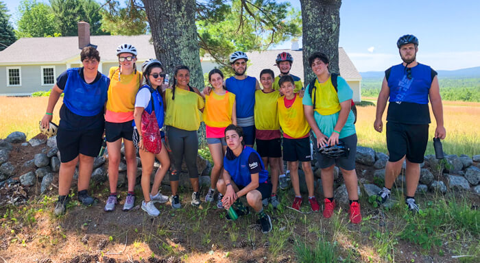 Group of campers preps for mountain biking