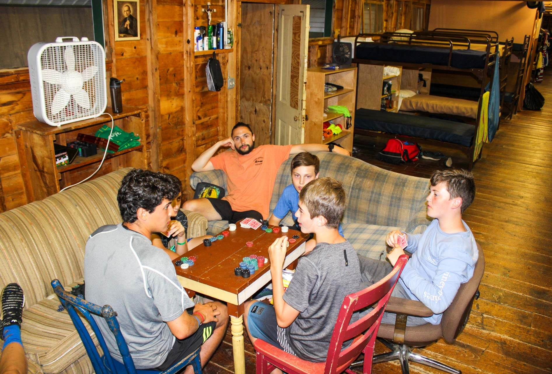 Boys lounge in camp cabin