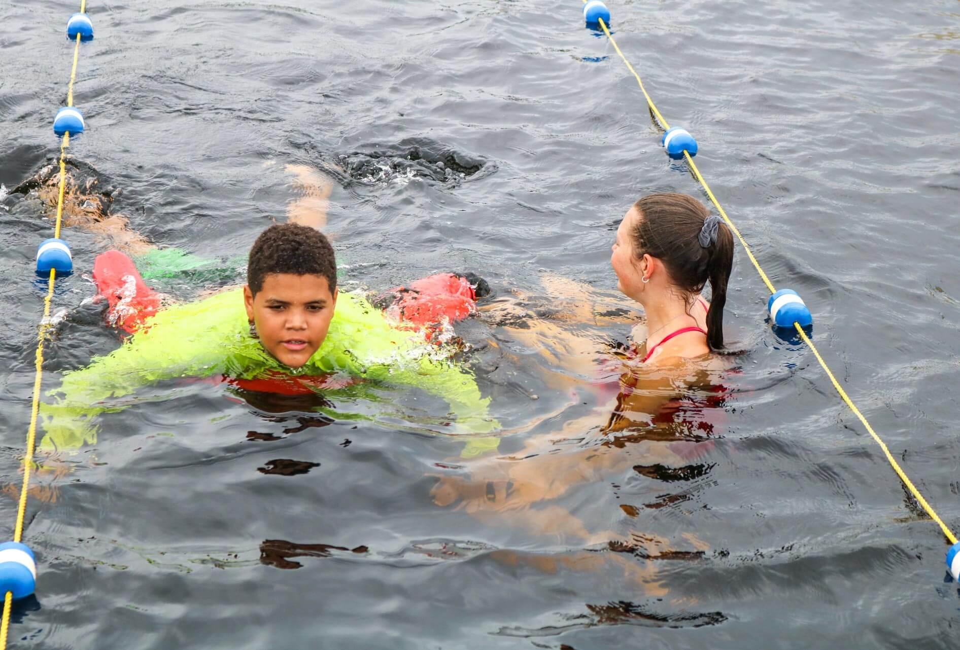 Camper uses noodle during swim instruction