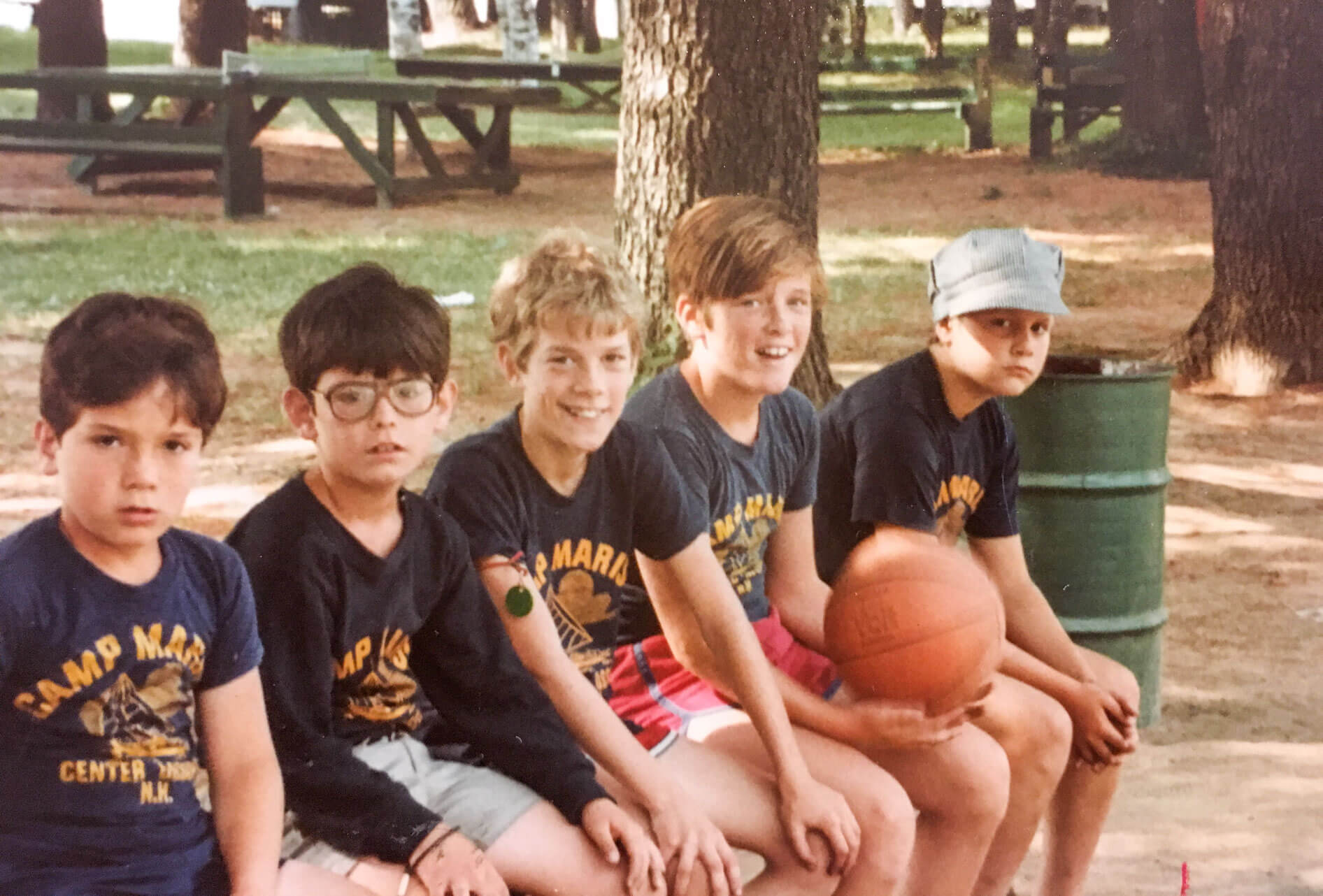 Throwback photo of campers sitting on bench