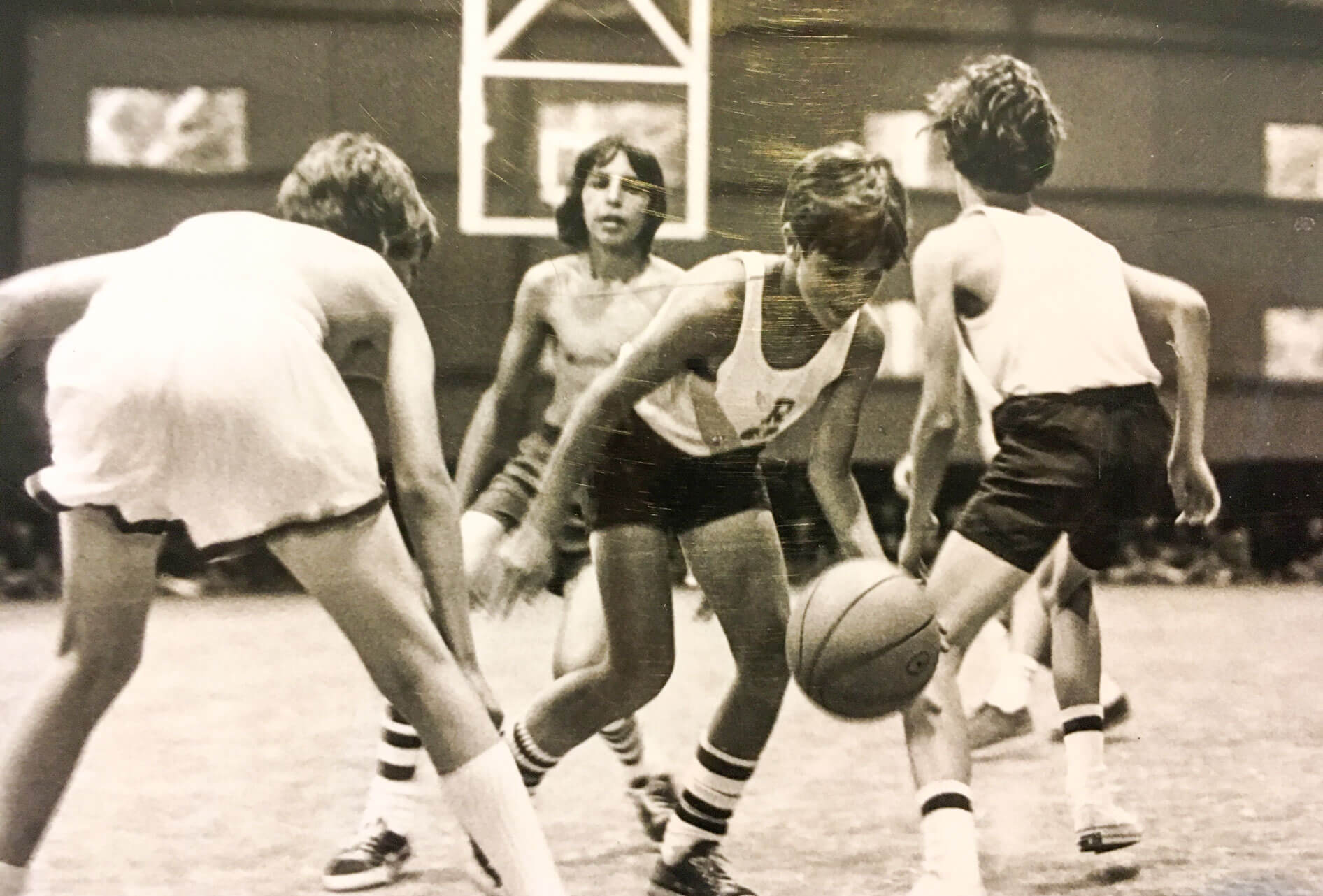 Black and white photo of campers playing basketball