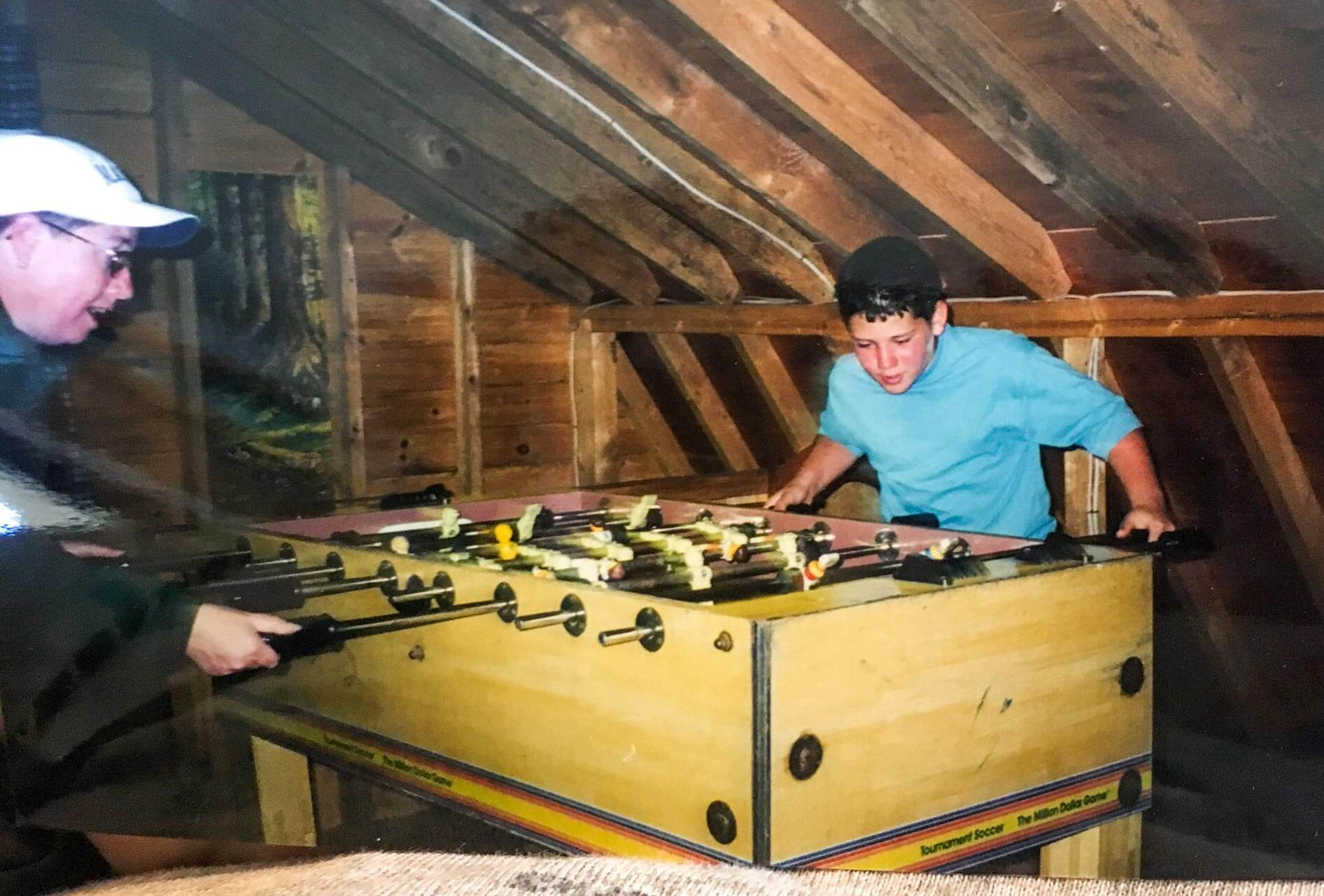 Throwback photo of camper playing foosball