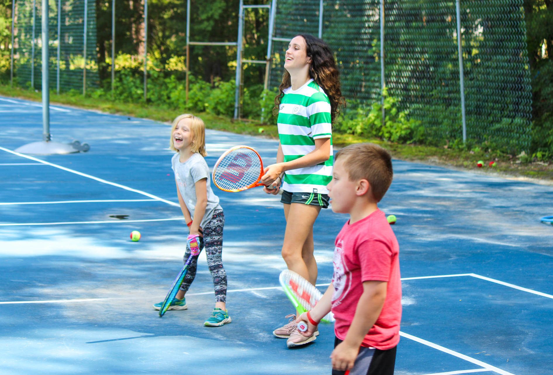 Young campers play tennis