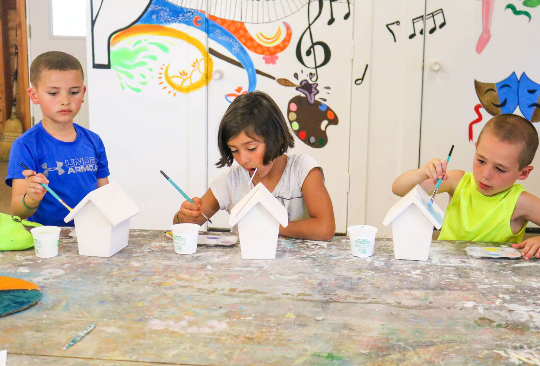 Young campers doing arts and crafts