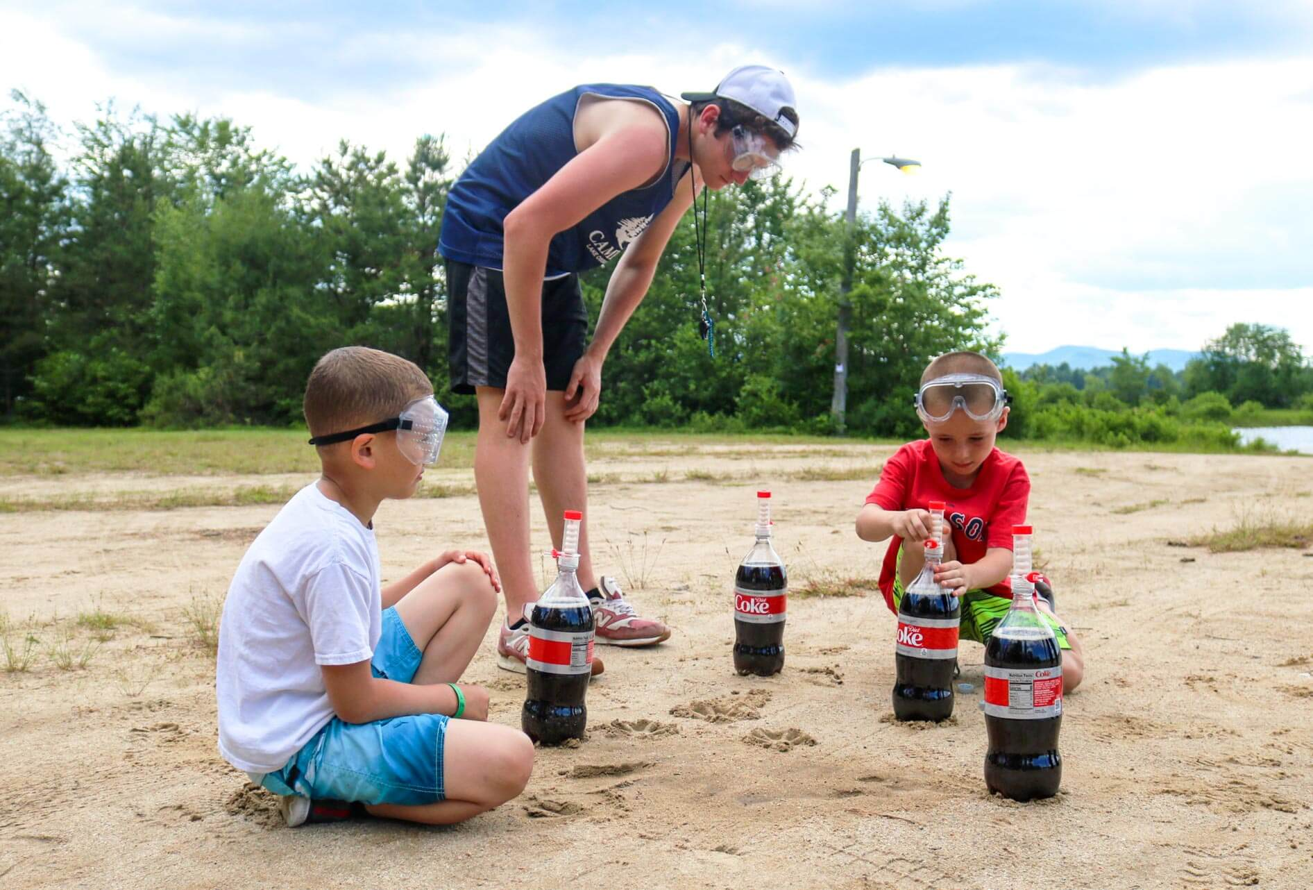 Counselor oversees young campers with Coke and Mentos